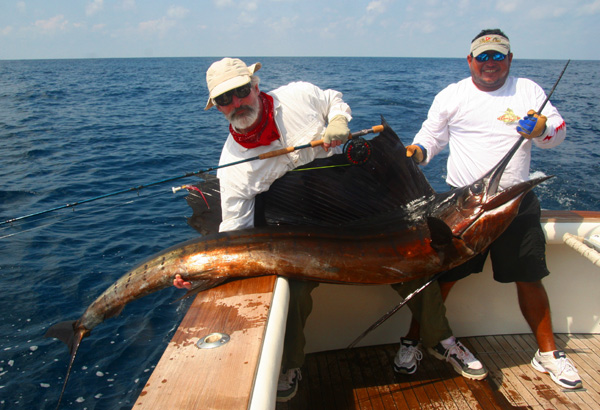 James Garrity and mate Jeffrey releasing first Sailfish on Fly at The Sailfish School in Guatemala, March 2009