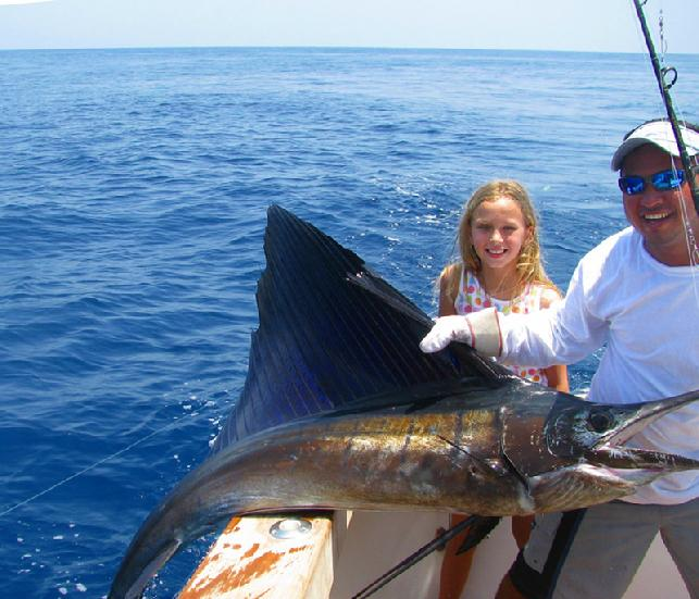 7 year old girl catcges several Sailfish