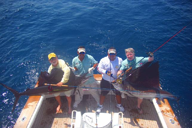 Sailfish School Double with anglers Danny Cline and Jake Jordan aboard Casa Vieja Lodge vessel Rum Line with Captain Chris Sheeder and mates Jeffrey and Ricardo, March 2009