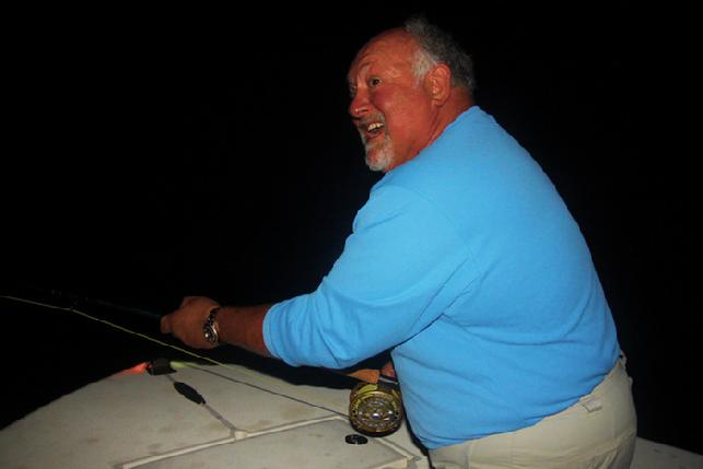 Ric Cox fighting big Florida Keys Tarpon on Fly Captain Jake Jordan