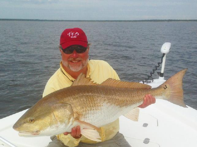 Captain Gary Dubiel, Releasing Neuse River Redfish, September 2013, Captain Jake Jordan Photo