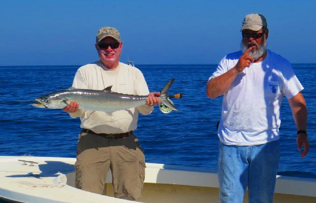 Angler John Langdon with Captain Joe Shute releasing fly caught Kingfish October 28 2014