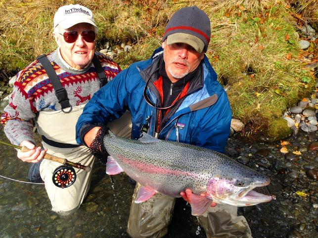 Nick Smith 31 inch Kenai Rainbow Trout on fly, Tony Weaver releasing awesome fish, Jake Jordan Photo, September 2016